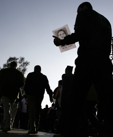 A man holds a photo of Singh. (Reuters)
