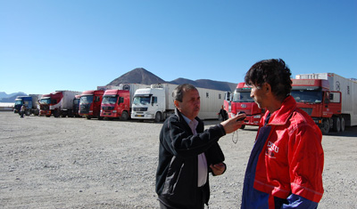 Urinboy Umanov, left, at work in Tajikistan.(BBC World Service)