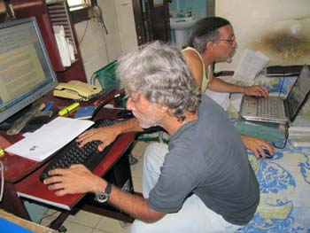 Febles, in back, and colleague Luis Cino work in the makeshift newsroom of Primavera Digital. (Courtesy Febles)