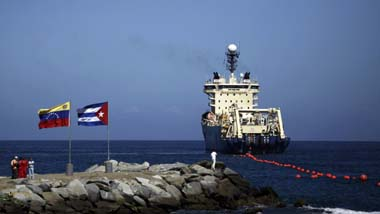In January, a ship lays fiber-optic cable linking Venezuela and Cuba, a project ushering high-speed Internet to the island. (AP/Ariana Cubillos)