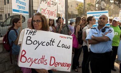 Israel's new law makes supporting boycott campaigns a civil offense. (AP)