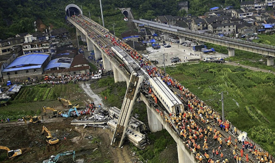 Chinese rescue workers by the wreckage of train cars in Wenzhou on Sunday. (AP/Color China Photo)