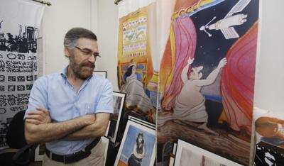 Ferzat in a photo taken August 14, before he was brutally attacked. (AP/Muzaffar Salman)