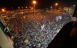 People gather near the courthouse in Benghazi on August 22. (Reuters)