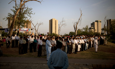 Pakistani journalists offer funeral prayers for their slain colleague Saleem Shahzad in June. (AP/B.K.Bangash)