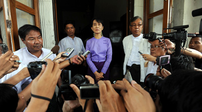 Opposition leader Aung San Suu Kyi speaks with reporters after a September meeting with the European Commissioner for International Cooperation. (AFP/Soe Than Win)