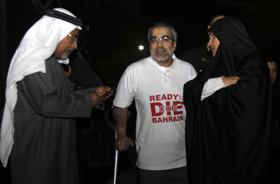 Abduljalil Alsingace, center, stands with his family after being released from prison in February. (AP)