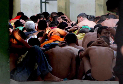 Inmates are subdued after a prison riot in Cabimas, Venezuela. Globovisión was fined more than US$2 million for its coverage of the uprising. (AP)