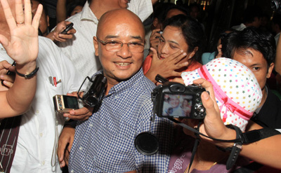 The Burmese comedian and blogger known as Zarganar arrives at the Yangon international airport Wednesday. (AP)