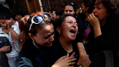 Copts mourn the victims killed during clashes with the Egyptian army. Blogger Alaa Abd el-Fattah was jailed over his coverage.(AP/Khalil Hamra)