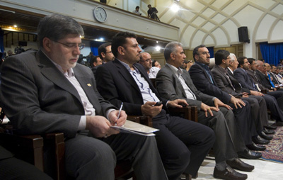 Ali Akbar Javanfekr, far left, director of the official Iranian News Agency, is among those recently charged. In this file photo, he attends a June presidential press conference. (Reuters/Caren Firouz)