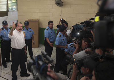 The media strategy of Nicaraguan President Daniel Ortega, shown after casting his ballot in Sunday's election, is to ignore journalists. (AP)