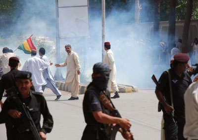 Pakistani police and supporters of the Baluchistan National Party clash in Quetta, Pakistan on July 14, 2010. (AP)