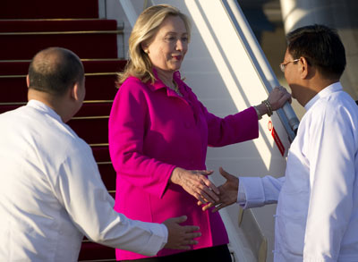 U.S. Secretary of State Hillary Clinto is greeted by Myanmar Deputy Foreign Minister Myo Myint, right, upon her arrival in Naypyidaw, Myanmar, Wednesday. (AP)