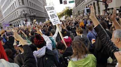 KGO cameraman Randy Davis was assaulted during an Occupy Oakland protest like this one. (AP)