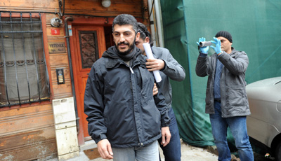AFP photographer Mustafa Ozer is detained at his home in Istanbul. (AFP/Bulent Kilic)