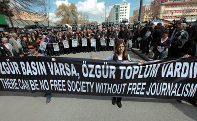 Hundreds of Turkish journalists march to protest detentions and demand reforms to media laws in Ankara on March 19, 2011. (AP Photo/Burhan Ozbilici)