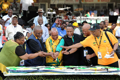 South African President Jacob Zuma, center, and other members of the ANC cut a cake celebrating the 100th year of the party. (EPA/Elmond Jiyane)