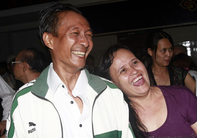 Win Maw, a journalist for Democratic Voice of Burma, is greeted by his wife as he arrives at Yangon airport after being released from prison Friday, Jan. 13. (AP/Khin Maung Win)