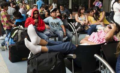 People remain stranded at the North Bus Terminal in Medellin, Antioquia department, on January 5, 2012 during an armed strike imposed by the criminal gang Los Urabeños. (Raul Arboleda/AFP)