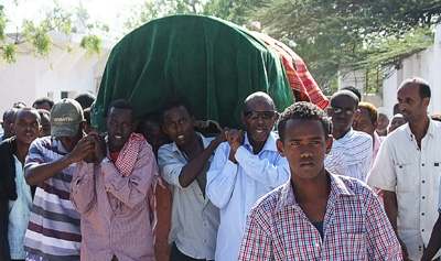 Somali people carry the coffin of journalist Hassan Osman Abdi, who was killed on Saturday evening. (AFP/Mohamed Abdiwahab)