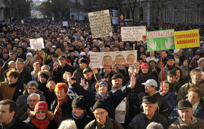 Hungarians demonstrate against the government's media law during a protest in support of the largest opposition radio station in Budapest Sunday. (AP Photo/Bela Szandelszky)