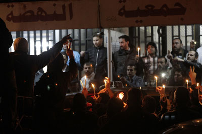 Syrians hold a candlelight vigil as the body of French tv reporter Gilles Jacquier is taken out of a hospital in Homs to be transported to Damascus early on Thursday. (AFP/Joseph Eid)