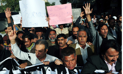 Pakistani journalists protest the death of Wali Khan Babar, killed one year ago today. (AFP/Asif Hassan)