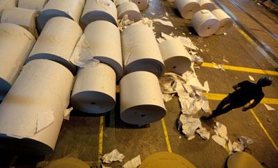 Newsprint manufacturer Papel Prensa is the recent focus of an ongoing battle between two dailies and Argentina's government. (AP/Natacha Pisarenko)
