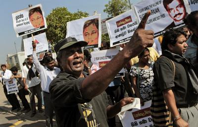 "Sri Lankan journalists stage the ""Black January"" protest, demanding the government punish the culprits responsible for killing journalists. (AP/Eranga Jayawardena)"