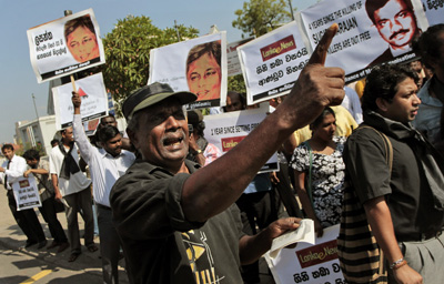 "Sri Lankan journalists stage the ""Black January"" protest, demanding the government punish the culprits responsible for killing journalists. (AP/Eranga Jayawardena)"