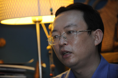 Writer Yu Jie was finally allowed to leave China. He arrived in Washington on Monday. (AFP/Peter Parks)