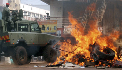 Civil unrest grips downtown Kampala. Ugandan President Yoweri Museveni said journalists who covered the protests were 'enemies' of the country's development. (AP/Stephen Wandera)