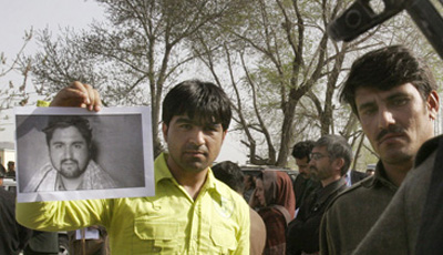 At a demonstration in Kabul, a photo of the slain Afghan journalist Ajmal Naqshbandi. (AP/Musadeq Sadeq)