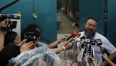 Ai Weiwei speaks to journalists at his home in Beijing after the government held him incommunicado for nearly three months. (AP/Ng Han Guan)