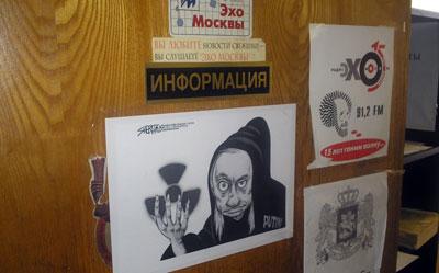 A poster depicts Vladimir Putin as the Grim Reaper on one of Ekho Moskvy's studio doors. (CPJ/Nina Ognianova)