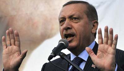 Turkish Prime Minister Recep Tayyip Erdoğan, buoyed by a landslide election victory, has led an attack on press freedom. (AP/Boris Grdanoski)
