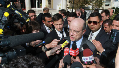 "French foreign minister Alain Juppe addresses reporters outside the ""Friends of Syria"" conference in Tunis. (AP/Amine Landoulsi)"