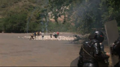 This screenshot from Sánchez's video is said to show police chasing protesters from the site of a proposed dam. (YouTube)