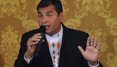 President Correa tells the nation he is pardoning the executives and journalists he sued for libel. (AFP/Rodrigo Buendia)