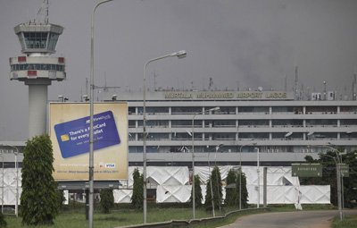 Over 60 journalists reporting from the Murtala Muhammed Airport in Lagos, Nigeria's commercial capital, are locked out of their long-time press center. (AP/Sunday Alamba)