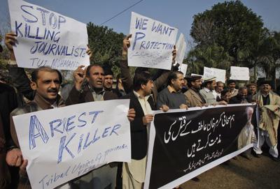 Pakistani journalists protest the killing of Mukarram Khan Aatif in Peshawar. (AP/Mohammad Sajjad)