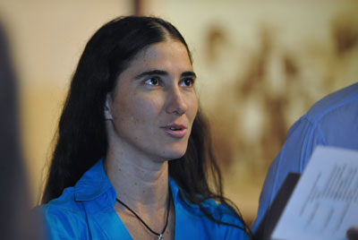 Blogger Yoani Sánchez says she has been denied permission to leave Cuba 19 times. (AFP/Adalberto Roque)