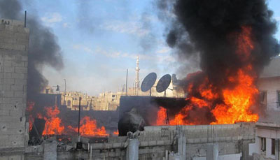 Journalists and other citizens are not being allowed to evacuate from the city of Homs, which has been repeatedly attacked by government forces. (AFP/LCC SYRIA)
