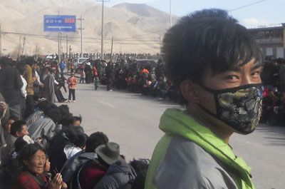 Tibetans gather on the side of a street in Nangqian county, China's Qinghai province, to protest Chinese rule. (AP)