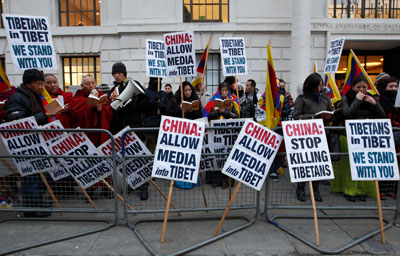 Tibetan monks lead a prayer vigil outside the Chinese Embassy in London Wednesday. (AFP/Justin Tallis)