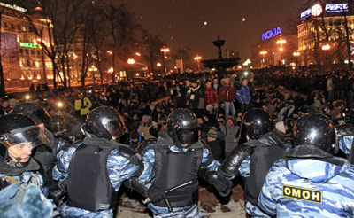 Police and protesters at Pushkin Square on Monday. (AP/Sergey Ponomarev)