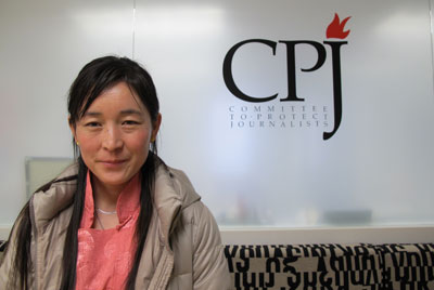 Lhamo Tso has traveled to Europe and America to publicize her husband Dhondup Wangchen's imprisonment. (CPJ)