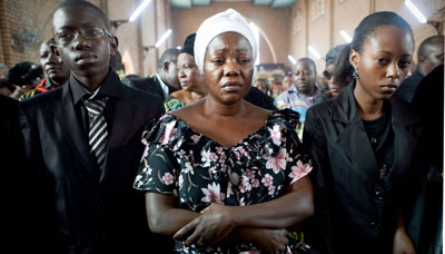 Chebeya's wife and two children at his funeral. (AFP)