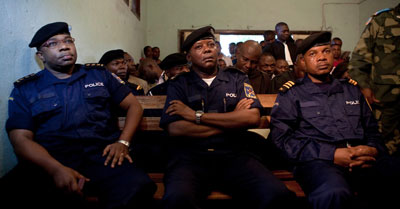 Police officers indicted for the murder of prominent human rights figure Floribert Chebeya attend their trial. (AFP)